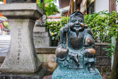 Ebisu statue god at Yasaka-jinja Shrine. Kyoto, Japan - May 7, 2016: Ebisu statue god of fishers or merchants is one of the seven gods of fortune at Yasaka-jinja Royalty Free Stock Photography