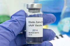 Ebola Vaccine Research. Ebola Zaire vaccine held by technician with laboratory research equipment Stock Images