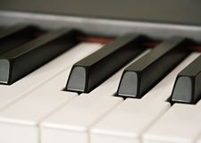 Ebony and Ivory. Close up view of piano keys with shallow dof stock photography