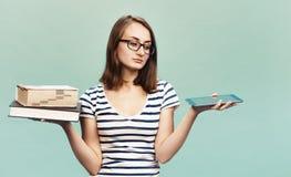 Ebook против книги Стоковая Фотография RF