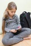 EBook чтения девушки Стоковое Изображение