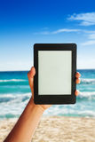 Ebook on beach background Royalty Free Stock Image