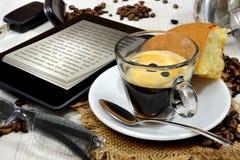 Ebook breakfast. Conceptual ebook reader un table and breakfast coffee Stock Photos