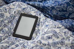 Ebook device with blank screen on a blanket Stock Photos