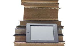 EBOOK AND  PRINTED BOOKS. STACK OF BOOKS AND ELECTRONIC BOOK READER Stock Images