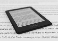 Ebook reader concept. Closeup view of an ebook reader, text is the Lorem Ipsum (3d render Royalty Free Stock Photos