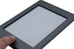 Ebook reader device touching. The home button on isolated white background Royalty Free Stock Images