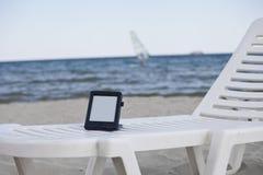 Ebook Reader. E-Book Reader on a beach chair Stock Photos