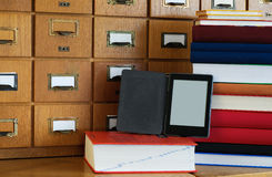 Ebook Reader in Front Library Catalogue - New Technology Concept Stock Photography