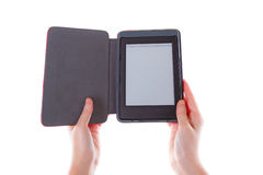 Ebook reader in hands with blank screen Stock Image