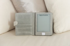 Ebook reader at home Royalty Free Stock Image