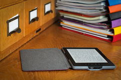 Ebook Reader in Library Royalty Free Stock Image