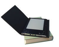EBook reader over book Royalty Free Stock Photo