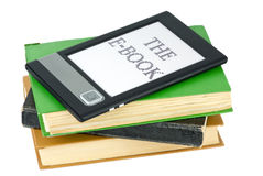 Ebook reader and traditional paper books Royalty Free Stock Photos
