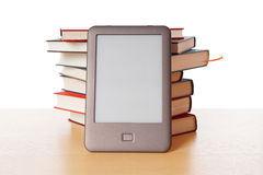 Ebook reader vs pile of books Stock Images