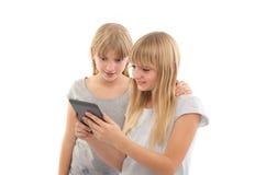 Ebook reading girls Stock Photo