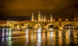 Ebro river and Stone bridge in Zaragoza. Ebro river and Stone bridge, with el Pilar basilica in Zaragoza Stock Images