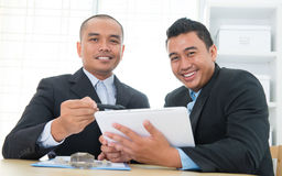 Ebusiness concept. Southeast Asian business people on ebusiness activity, sitting in office Royalty Free Stock Photography
