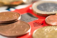 EC Card with Euro coins. Money and banknotes royalty free stock photo