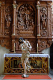 Ecce homo scene Jesus Christ statue at altar. Life-sized depiction of Jesus Christ with loincloth, scourged and in pain - Ecce Homo scene. Christian art in the Stock Image