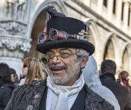Eccentric Character. Venice, Italy- February 18th, 2012: Environmental portrait of aa eccentric man funny disguised during the Venice Carnival days Royalty Free Stock Image