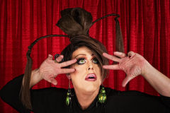 Eccentric Drag Queen Looking Up. With fingers near face Royalty Free Stock Image