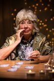 Eccentric elderly lady with cards Royalty Free Stock Photo