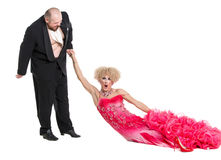 Eccentric Fat Man Dragging a Woman by the Hand Lying on Floor Stock Photography