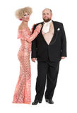Eccentric Fat Man in a Tuxedo and Beautiful Lady in an Evening D Royalty Free Stock Image