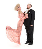 Eccentric Fat Man in a Tuxedo and Beautiful Lady in an Evening D Stock Photos