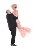 Eccentric Fat Man in a Tuxedo and Beautiful Lady in an Evening D Royalty Free Stock Photos