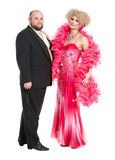 Eccentric Fat Man in a Tuxedo and Beautiful Lady in an Evening D. Ress, drag queen artists on white background royalty free stock photos