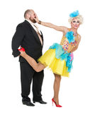 Eccentric Fat Man in a Tuxedo and Beautiful Lady in an Evening D. Ress, drag queen artists on white background royalty free stock image