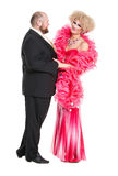 Eccentric Fat Man in a Tuxedo and Beautiful Lady in an Evening D. Ress, drag queen artists on white background stock photo