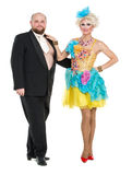 Eccentric Fat Man in a Tuxedo and Beautiful Lady in an Evening D. Ress, drag queen artists on white background royalty free stock photo