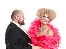 Eccentric Fat Man in a Tuxedo and Beautiful Lady in an Evening D. Ress, drag queen artists on white background royalty free stock images