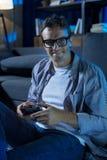 Eccentric fun guy enjoying his quiet leisure at home Stock Photos