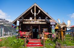 A eccentric little gift shop in alaska. A whimsically decorated log cabin selling souvenirs on the waterfront at whittier Royalty Free Stock Photos