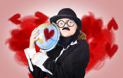 Eccentric man showing world love by cuddling globe Royalty Free Stock Photo