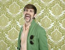 Eccentric retro mustache geek man salesperson. Sixties seventies stock photography