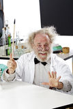 Eccentric scientist in lab explaining idea Royalty Free Stock Photos