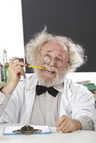 Eccentric scientist in lab thinks of ideas Stock Image