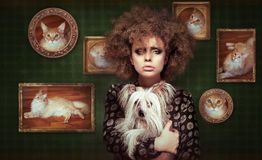Eccentric Shaggy Woman with Pet - Little Puppy Royalty Free Stock Photography