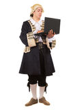 Eccentric young man. In medieval costume posing with a laptop. Isolated on white Stock Images