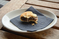 Eccles cake on plate. Half-eaten Eccles cake on plate Stock Image