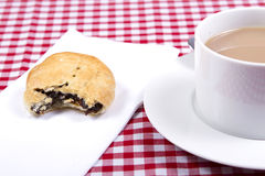 Eccles cakes. An eccles cake with a cup of tea Royalty Free Stock Photography