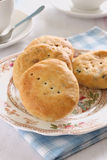 Eccles Cakes. Eccles cake is a small round pastry filled with currants originating from the town of Eccles in Northern England Royalty Free Stock Image