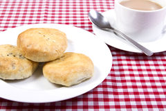 Eccles cakes. A plate of eccles cakes with a cup of tea Stock Image