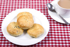 Eccles cakes. A plate of eccles cakes with a cup of tea Stock Images