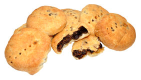 Eccles Cakes. Traditional English Eccles cakes with flaky butter pastry filled with currants, also known as squashed fly cakes, isolated on a white background Royalty Free Stock Photos